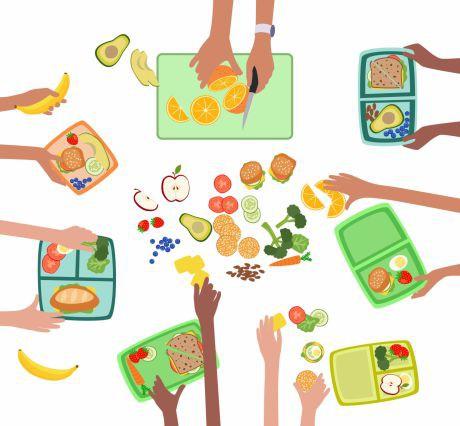 Jausenboxen, die mit Obst und Gemüse gefüllt werden